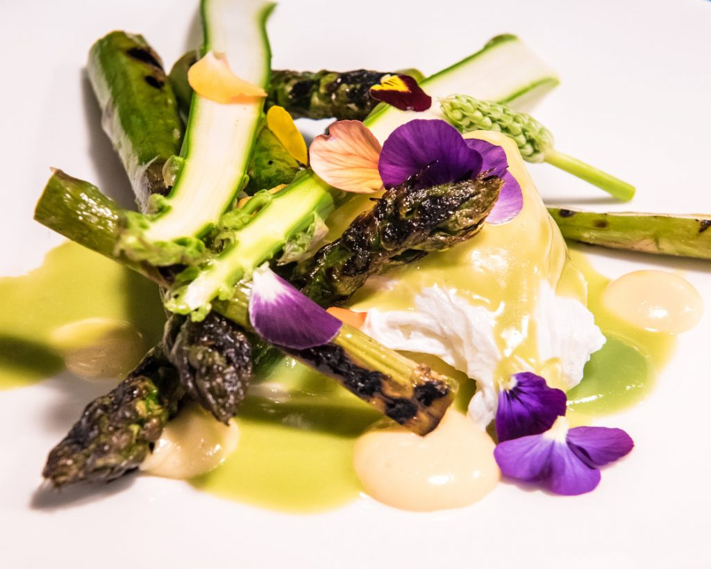 Char-grilled Asparagus, Mustard Emulsion, Poached Egg & Edible Flowers (Photo: Julia Claxton)
